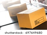 packages boxes on conveyor belt ... | Shutterstock . vector #697649680