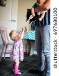 toddler sibling wanting mommy... | Shutterstock . vector #697680100
