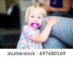 little girl toddler with... | Shutterstock . vector #697680169