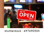 we are open daily sign on shop... | Shutterstock . vector #697690504