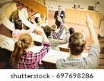 rear view of students raising...   Shutterstock . vector #697698286