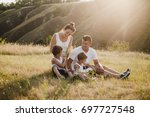 parents with children on a... | Shutterstock . vector #697727548