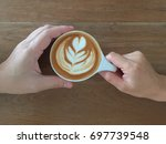 a woman and man hands hold a... | Shutterstock . vector #697739548