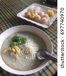 rice porridge  congee  with... | Shutterstock . vector #697740970