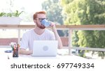 Small photo of Taking Sip of Hot Coffee, Drinking while Sitting in Outdoor Office, Red Hairs