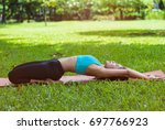 young woman doing yoga in... | Shutterstock . vector #697766923