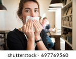 girl in the cafe  wipes his... | Shutterstock . vector #697769560