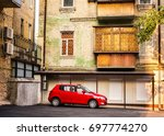 lonely red car is waiting for... | Shutterstock . vector #697774270