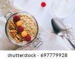 morning breakfast  oatmeal with ... | Shutterstock . vector #697779928