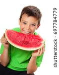 smiling boy with slice of... | Shutterstock . vector #697784779