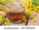 a cup of herbal hypericum tea... | Shutterstock . vector #697785040