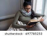 Woman Reading Book By Window O...