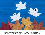 making ghosts from maple leaves ... | Shutterstock . vector #697800859