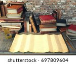 old paper and ancient books on... | Shutterstock . vector #697809604