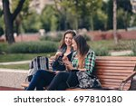 modern girls sitting on a... | Shutterstock . vector #697810180