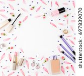 frame with lipstick  brush and... | Shutterstock . vector #697839070
