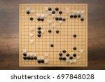 """go"" board game on wooden desk... | Shutterstock . vector #697848028"
