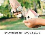 close up hand giving money...   Shutterstock . vector #697851178