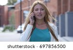 outdoor girl talking on phone ... | Shutterstock . vector #697856500
