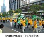 KOBE, JAPAN - MAY 12: Brazilians of Japanese descent marching in a parade May 12, 2007 in Kobe, Japan. - stock photo