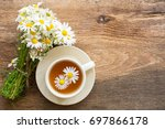 cup of herbal chamomile tea... | Shutterstock . vector #697866178