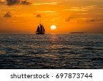 Tall Ship Silhouetted By The...