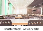 Stock photo modern interior of cafeteria or canteen with chairs and tables nobody 697879480