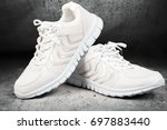 pair of white  sports shoes... | Shutterstock . vector #697883440