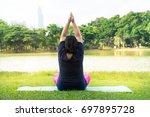overweight asian woman exercise ... | Shutterstock . vector #697895728