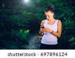 white girl in the forest... | Shutterstock . vector #697896124