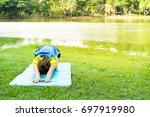 asian woman workout in green... | Shutterstock . vector #697919980