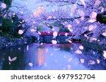 petals falling technology in... | Shutterstock . vector #697952704