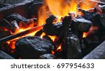 coal with burning fire and iron. | Shutterstock . vector #697954633