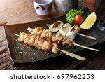 chicken skin grilled with... | Shutterstock . vector #697962253