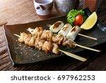 chicken skin grilled with... | Shutterstock . vector #697962253