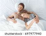 top view of young tender couple ... | Shutterstock . vector #697977940