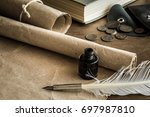 old quill pen on the old paper. ... | Shutterstock . vector #697987810