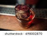 bright red alcohol cocktail... | Shutterstock . vector #698002870