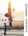 aircraft engineer is checking... | Shutterstock . vector #698004226