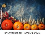A Table Decorated With Pumpkin...