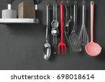 kitchen utensils hanging with