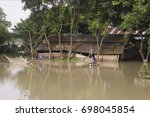 Small photo of 16th August 2017 in Marigaon, Assam, India. A house under water in a flood affected area.