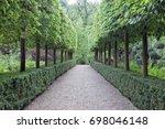 walking stone path between rows ... | Shutterstock . vector #698046148