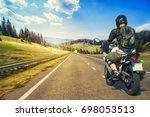motorcyclist rushes along the...   Shutterstock . vector #698053513