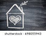 house and heart on chalk board | Shutterstock . vector #698055943