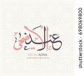 arabic calligraphy of eid al... | Shutterstock .eps vector #698069800