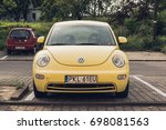 yellow new volkswagen beetle... | Shutterstock . vector #698081563