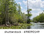 a fishing boat on a swamp... | Shutterstock . vector #698090149