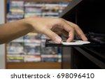 Hand Holding Dvd Insert To Dvd...