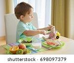 little kid boy having healthy... | Shutterstock . vector #698097379